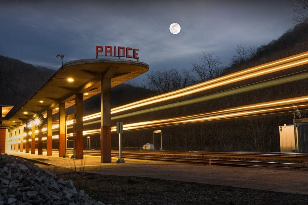 The full moon rises above the passenger station at Prince.