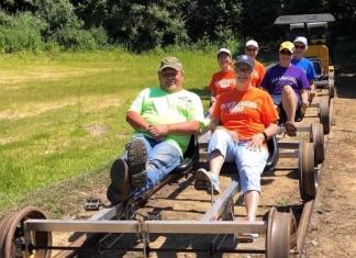 Riders pedal along the old Buffalo Creek & Gauley Railroad, now a rail-trail near Clay, West Virginia.
