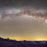 The full arch of the Milky Way stretches across the horizon on a clear night atop Spruce Knob, the highest point in West Virginia.