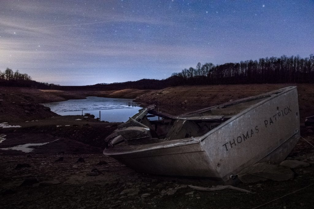 An abandoned boat lies stranded during a drawdown at Summersville Lake.