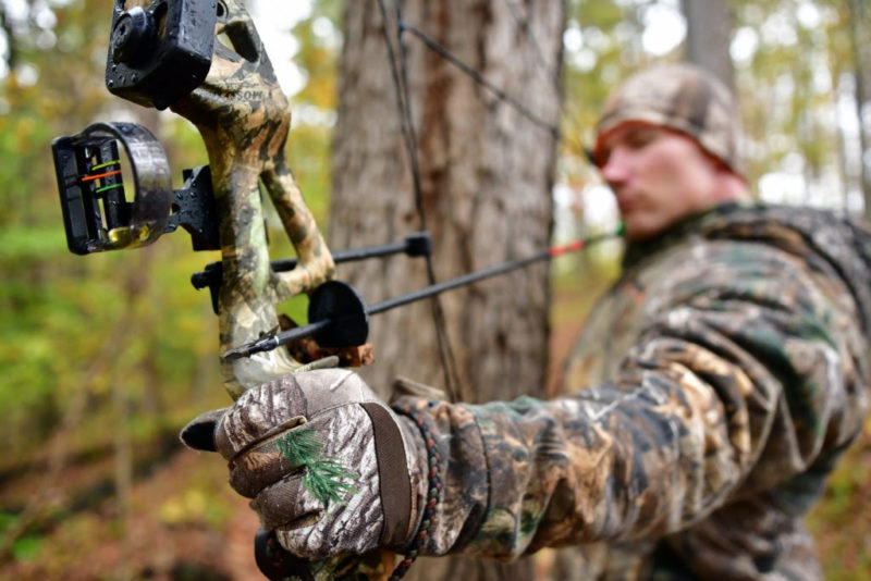 An archer in the West Virginia forest draws his bow. Photo courtesy W.Va. Dept. of Commerce.