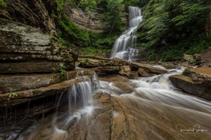 Cathedral Falls drops over sandstone ledges on its descent to the New River near Gauley Bridge, West Virginia.