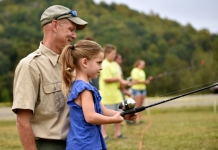 A youth learns to cast at Stonewall Resort State Park. Photo courtesy W.Va. Dept. of Commerce.
