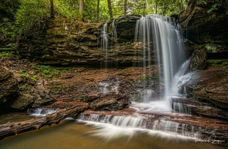 The upper falls of Hills Creek tumbles over a cliff and into the ravine through which two other falls descend.