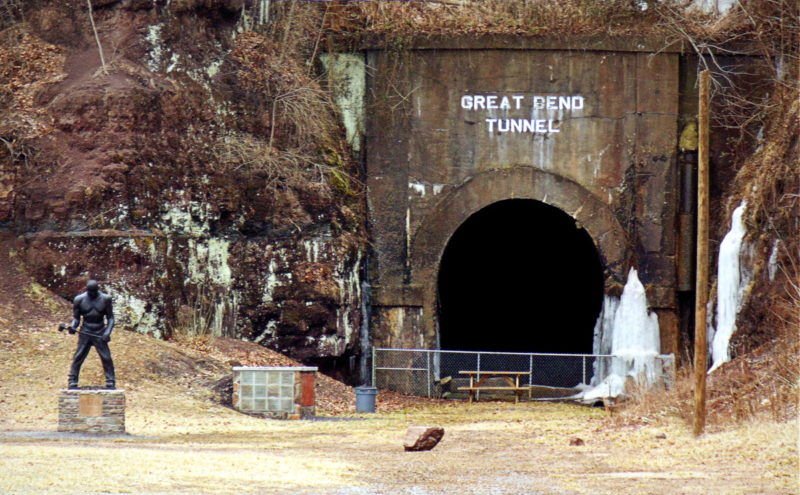 A statue of folk-hero John Henry has moved move to the east portal of the Big Bend Tunnel near Talcott, West Virginia (WV).