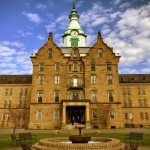 Dwarfed by its massive tower, hosts flanking the front door welcome guests to the Trans-Allegheny Lunatic Asylum.