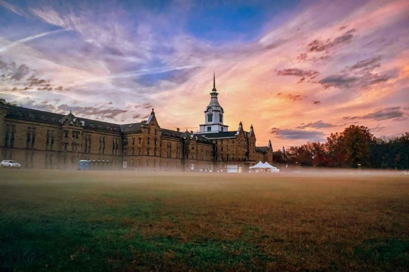 Mist gathers around the Trans-Allegheny Lunatic Asylum on the West Fork River in Weston, West Virginia.