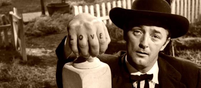 Robert Mitchem displays LOVE-HATE tattoos in