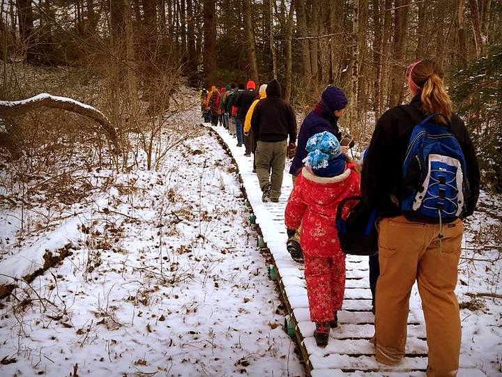 Hikers cross a boardwalk through a marsh near Beckley, West Virginia. Photo courtesy Active SWV.