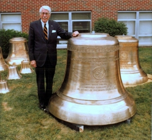 The late Dr. Marsh stands alongside the largest of bells that hang in the Concord University carillon.