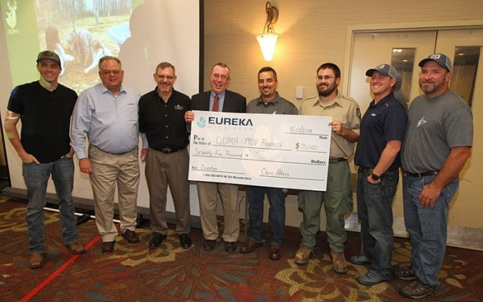 Greg Dotson, director of environmental health and safety for Eureka Midstream, presented the $75,000 to the Mid-Ohio Valley Branch of Quality Deer Management Association at the 2018 Mountaineer QDMA banquet in Morgantown, West Virginia.