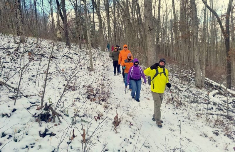 Levi Moore leads a winter hike through the woods in southern West Virginia.