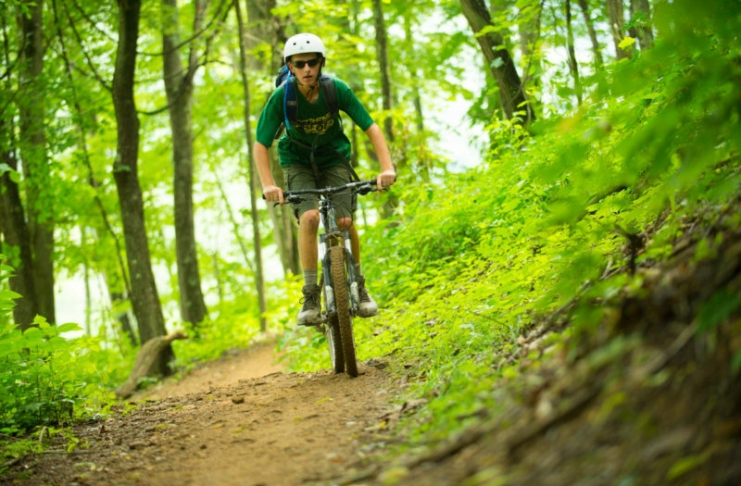 A mountain biker explores trails at the Summit Bechtel Scout Reserve near the New River Gorge.