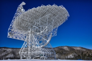 A radio-telescope at Green Bank Observatory looks skyward. Photo by Rick Burgess.