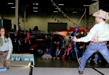 Frank Addington, Jr., takes aim at aspirin at the W.Va. Hunting and Fishing Show.