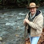 David Sibray, editor and publisher of West Virginia Explorer, explores a mountain stream.