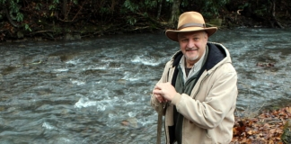 David Sibray, editor and publisher of West Virginia Explorer, explores a mountain stream.