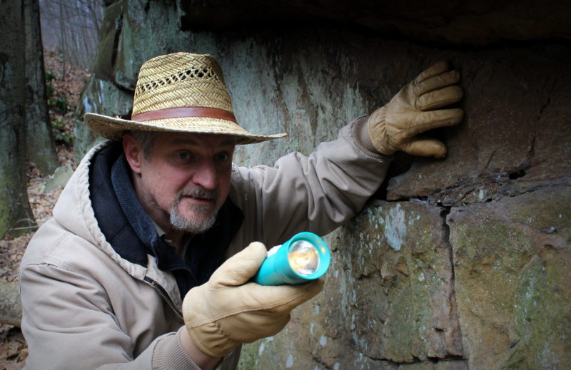 David Sibray peers into a cave system in southern West Virginia.