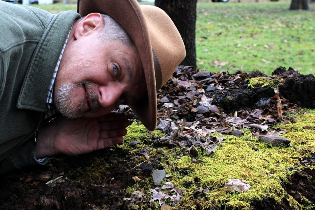 """David Sibray listens for """"Old Thump,"""" the origins of which may be geologic."""
