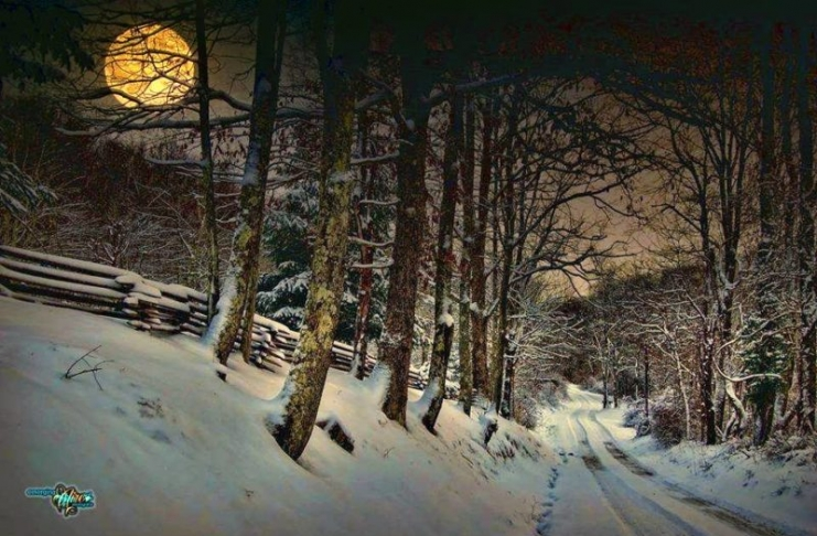 A snow moon rises along a country road in West Virginia. Photo courtesy Chuck Reed of Emerging Aire PhotoGrafix.
