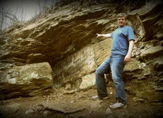 Historian David Sibray in the 1990s visits ancient inscriptions near Lynco, West Virginia.