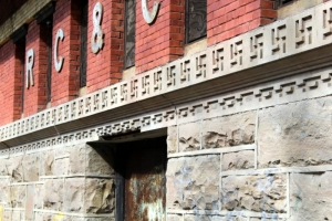 A close-up of swastika emblems on this building in Raleigh, West Virginia, reveals other architectural details.