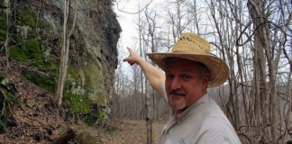 David Sibray points to the profile of President William McKinley, blasted into a cliff near Thurmond in 1901.