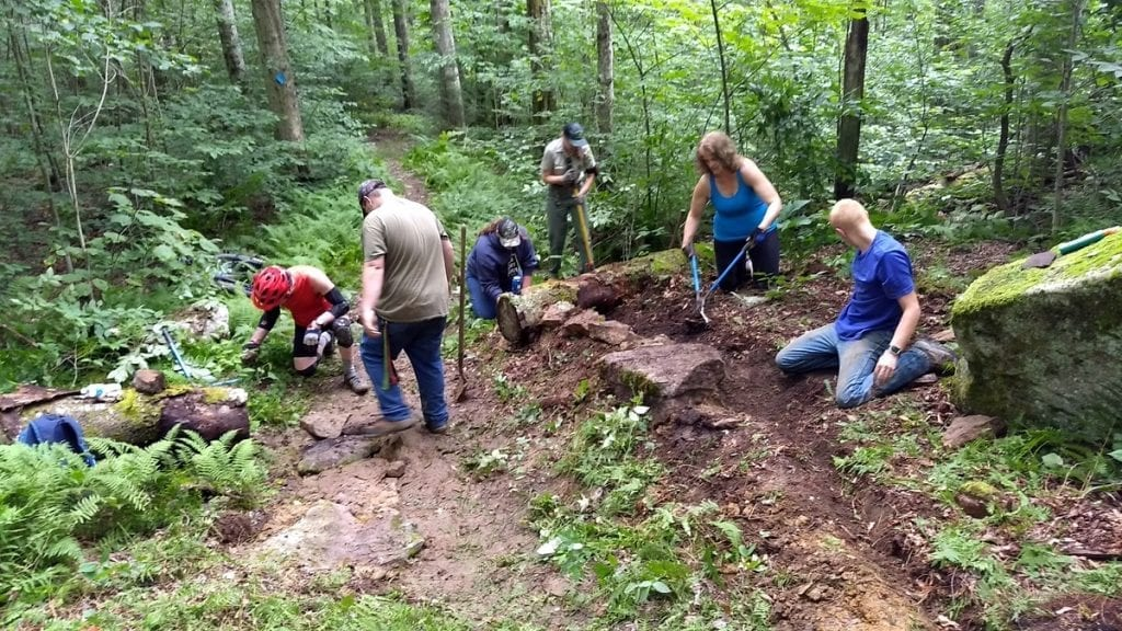 Volunteers with the New River Gorge Trail Alliance repair trail in the Monongahela National Forest with forest service staff and Youth Conservation Corp members.