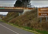 A sign recognizing the Eastern Continental Divide rises along I-68 in Maryland. Google Maps image.