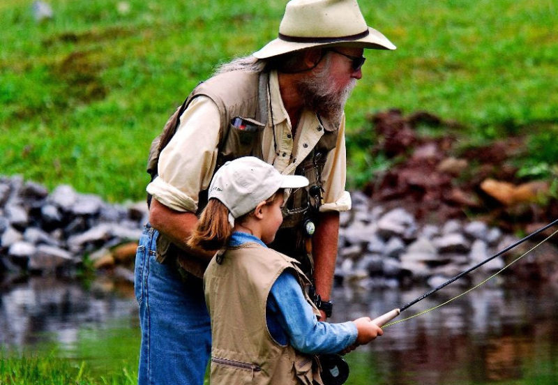A father and daughter enjoy family fishing trip in West Virginia. Photo courtesy W.Va. Dept. of Commerce.