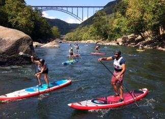 Racers on stand-up paddleboards ply the New River near Fayetteville, West Virginia. Photo courtesy Active SWV.