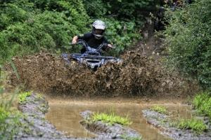 An ATV plows through a mudhole. Photo courtesy New River ATV Tours.
