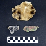 Artifacts from an Adena mound in Marshall County include mica (top), quartz (bottom left), and copper (bottom right). Courtesy Dept. of Arts, Culture, and History, Grave Creek Mound Archaeological Complex.