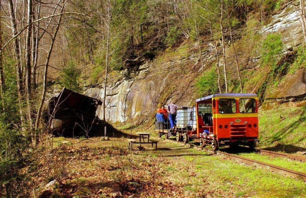 Passengers pass a wreck along the old Buffalo Creek & Gauley Railroad.