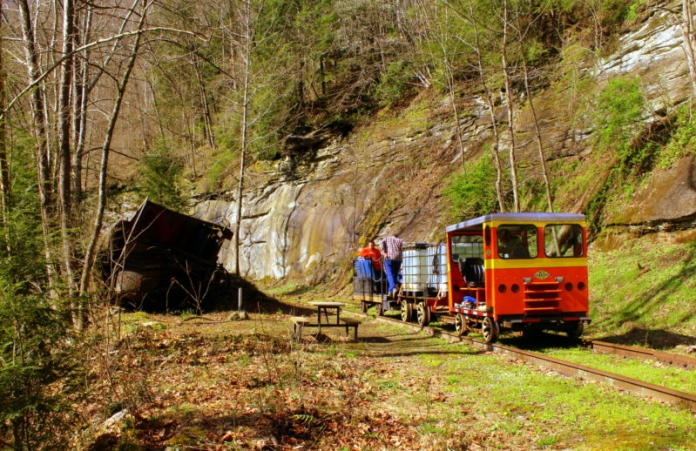 Passengers pass a wreck along the old Buffalo Creek & Gauley Railroad.