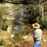 David Sibray visits a waterfall along the Buffalo Creek and Gauley Railroad during an excursion.