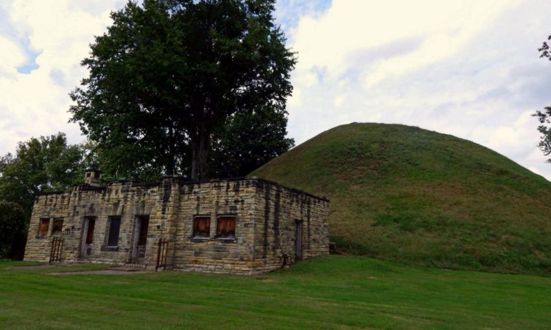 The Grave Creek Mound rises behind an early visitor center. Photo courtesy Charity Moore.