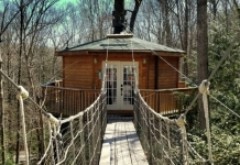 A suspended bridge leads to the Holly Rock Treehouse.