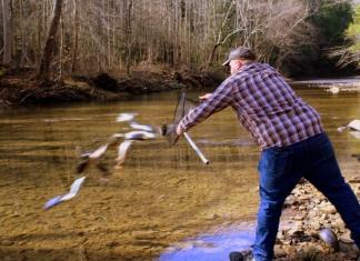 Joe Wood stocks trout in Buffalo Creek near Clay in Clay County,