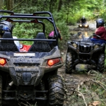 ATVers navigate a muddy trail near the New River Gorge. Photo courtesy New River ATV Tours.