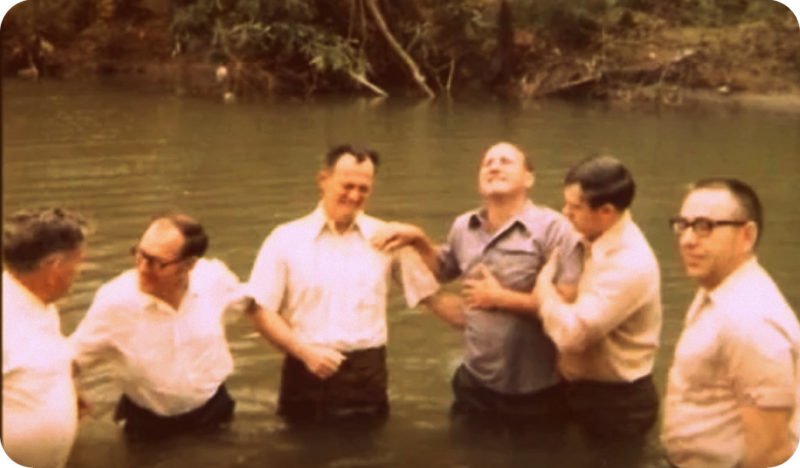 The father of Shirley Stewart Burns is baptized in southern West Virginia.