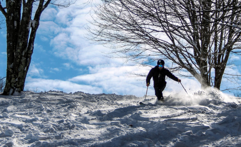 A skier maneuvers through powder at Canaan Valley Ski Resort. Photo courtesy Canaan Valley Resort State Park.