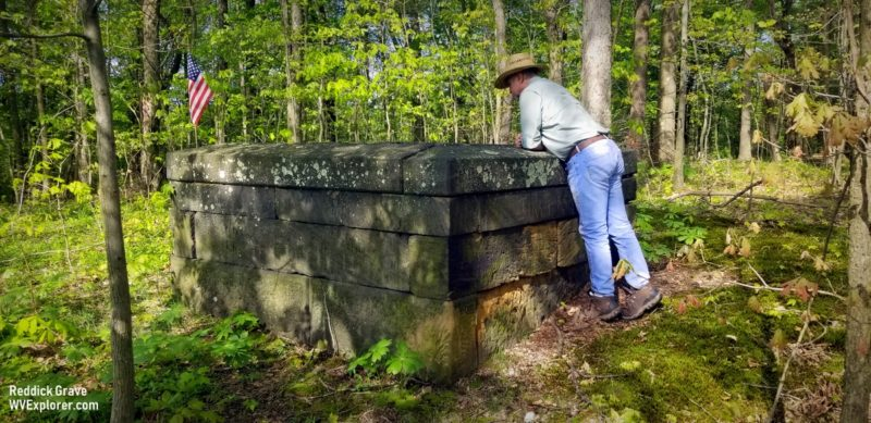 David Sibray peers into the grave of Judge John Reddick, buried in both Virginia and Pennsylvania.