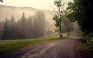 Fog rises off Keener Ridge in the hills above Strange Creek in Braxton County.