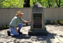 David Sibray inspects the Point of Beginning Monument near the West Virginia border.