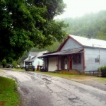 The village of Strange Creek follows a country road into the West Virginia hills.