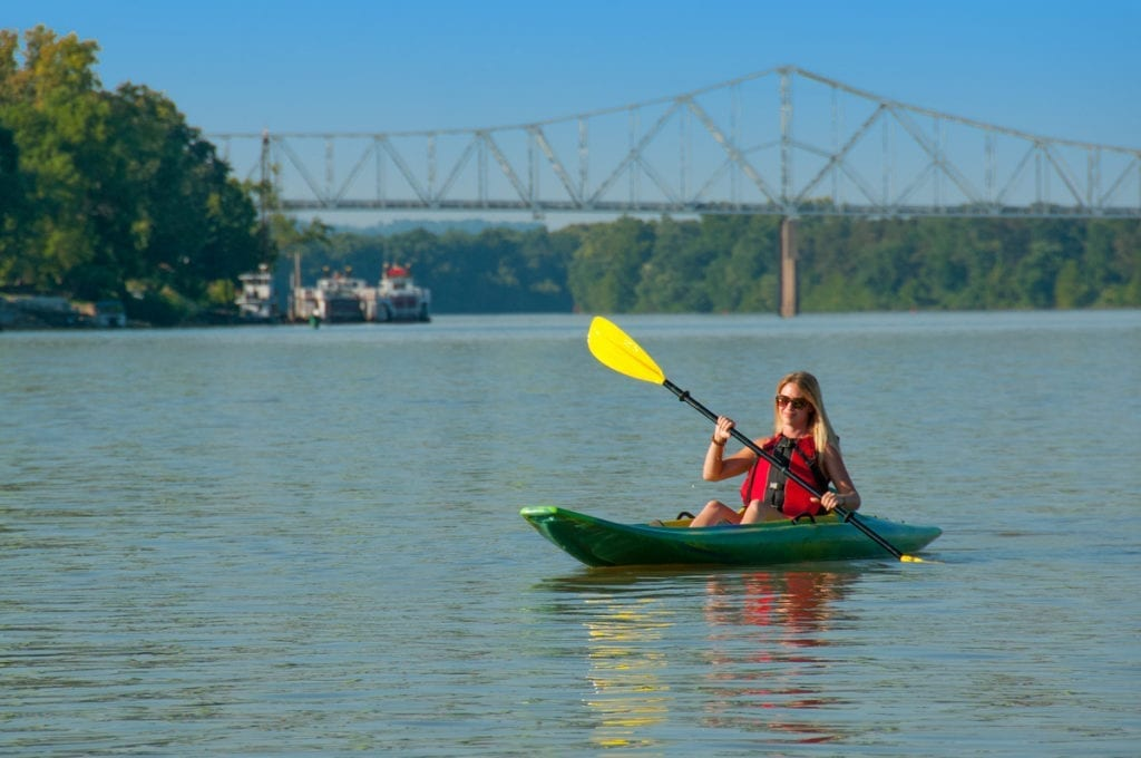 A kayaker plies the gentle Ohio River near Parkersburg, West Virginia, once the site of the infamous Graveyard of the Ohio.