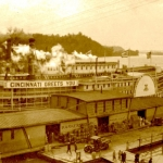 Waterfront scene showing Parkersburg wharf boat and Louisville & Cincinnati Packet Co. boat at Parkersburg, West Virginia, circa 1925.