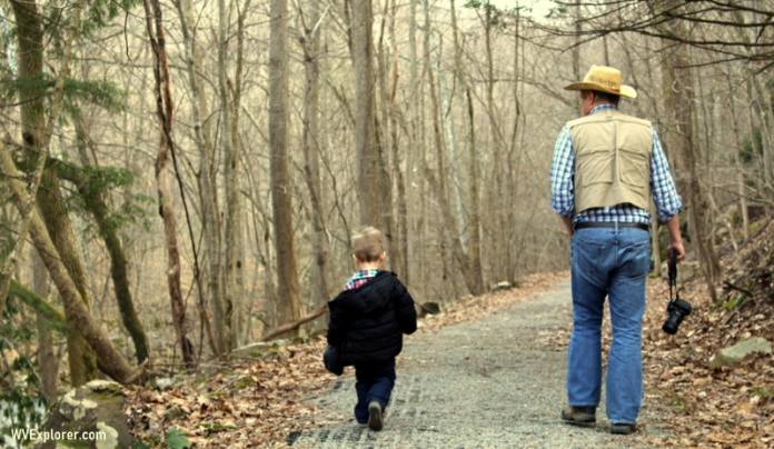 West Virginia Explorer editor David Sibray hikes the Glade Creek Trail in West Virginia with a young friend.