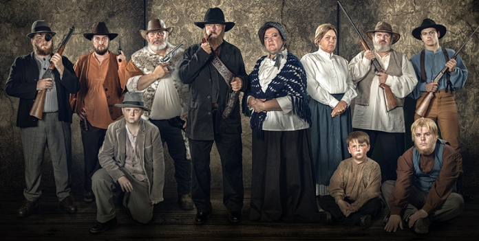 Hatfield family performers pose for a promotional portrait for